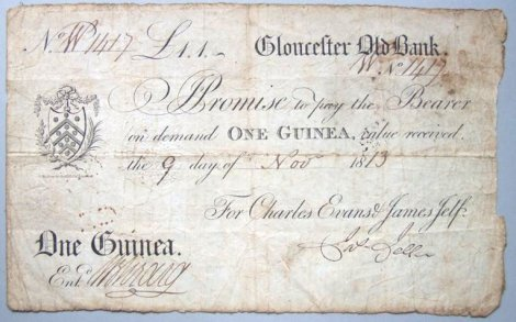 1813_One_Guinea_Gloucester_Old_Bank_banknote